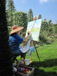 Kunstenaar hard aan het werk op schilderij tijdens schilderdag